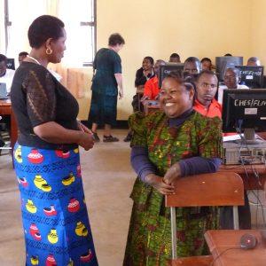 Tanzania -Treasurer Naomi with Grad Teresia teaching computers